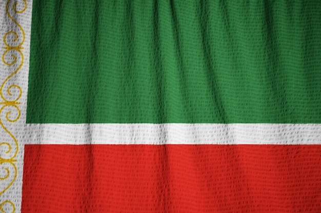 Closeup of ruffled chechen republic flag, chechen republic flag blowing in wind