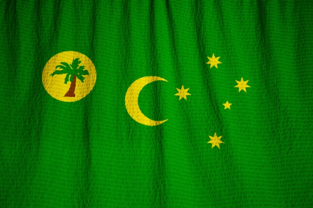 Closeup of ruffled cocos islands flag, cocos islands flag blowing in wind