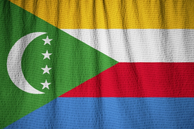 Closeup of ruffled comoros flag, comoros flag blowing in wind