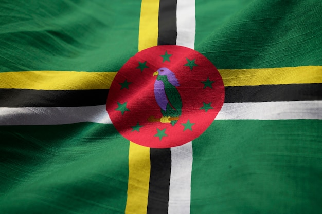 Closeup of ruffled dominica flag, dominica flag blowing in wind