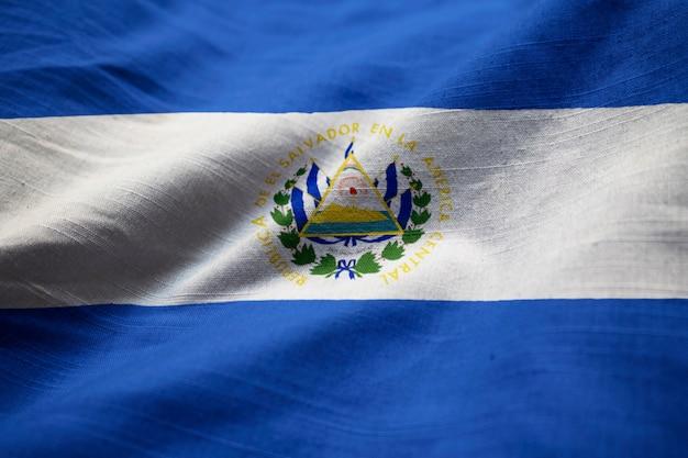 Closeup of ruffled el salvador flag, el salvador flag blowing in wind