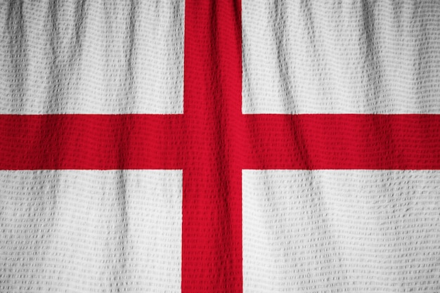 Closeup of ruffled england flag, england flag blowing in wind