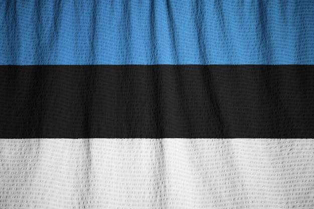 Closeup of ruffled estonia flag, estonia flag blowing in wind