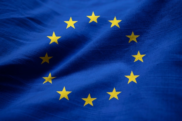Closeup of ruffled european union flag, european union flag blowing in wind
