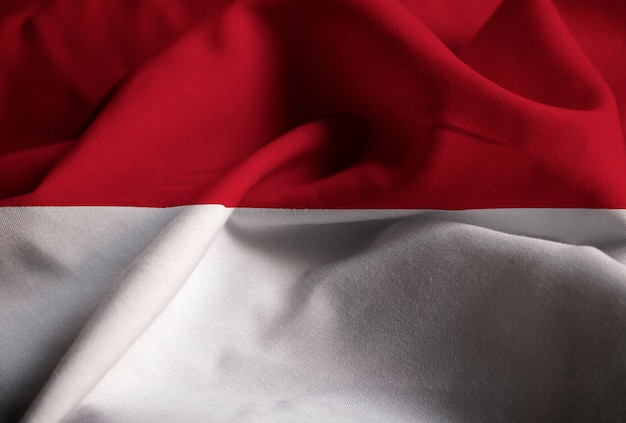 Closeup of ruffled indonesia flag, indonesia flag blowing in wind