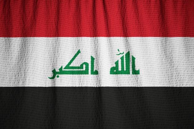 Closeup of ruffled iraq flag, iraq flag blowing in wind