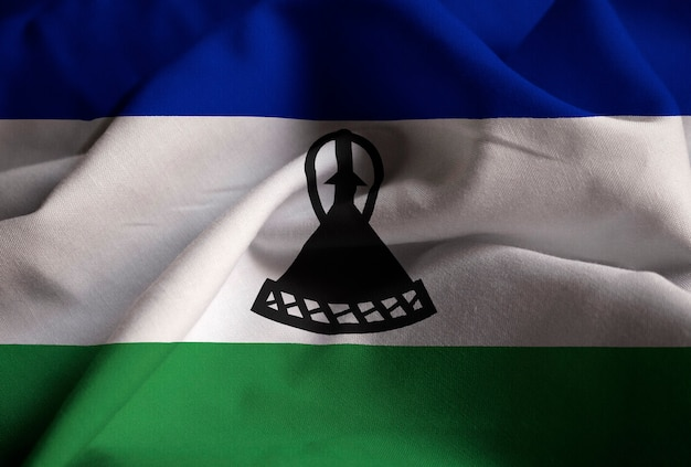 Closeup of ruffled lesotho flag, lesotho flag blowing in wind