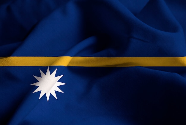 Closeup of ruffled nauru flag, nauru flag blowing in wind