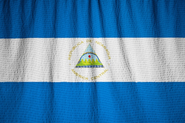 Closeup of ruffled nicaragua flag, nicaragua flag blowing in wind
