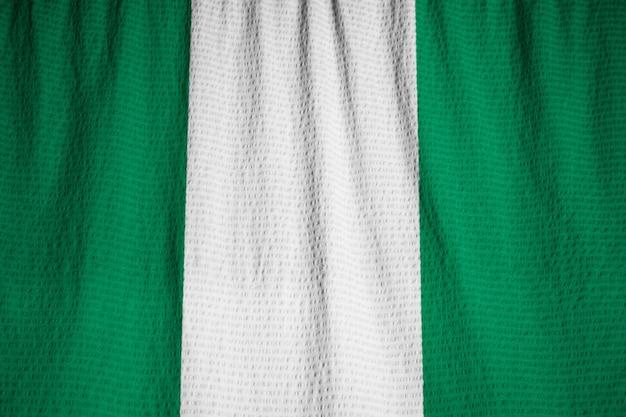 Closeup of ruffled nigeria flag, nigeria flag blowing in wind
