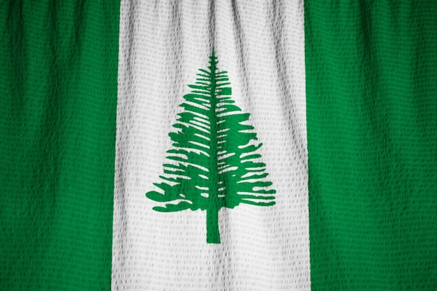 Closeup of ruffled norfolk island flag, norfolk island flag blowing in wind