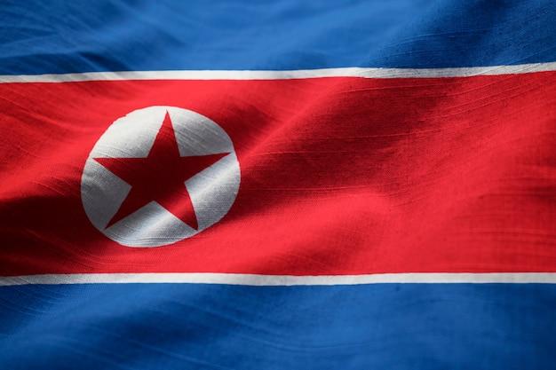 Closeup of ruffled north korea flag, north korea flag blowing in wind