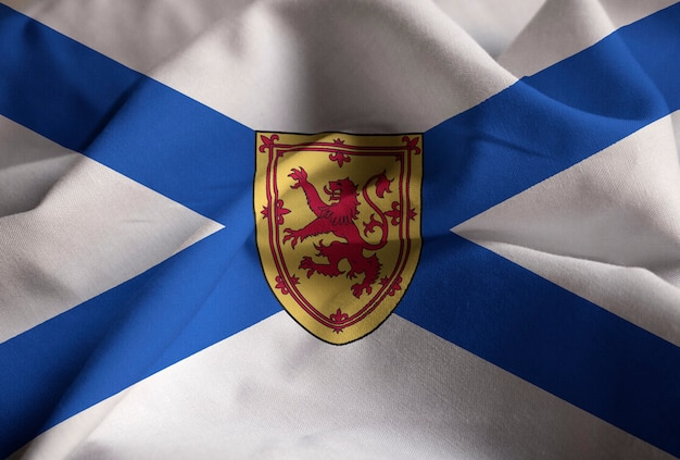 Closeup of ruffled nova scotia flag, nova scotia flag blowing in wind