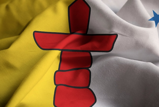 Closeup of ruffled nunavut flag, nunavut flag blowing in wind