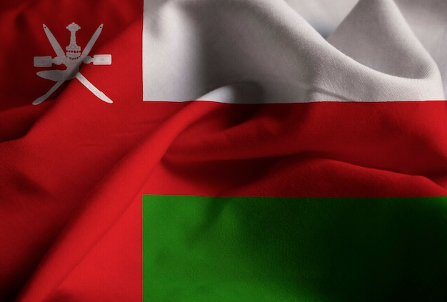 Closeup of ruffled oman flag, oman flag blowing in wind