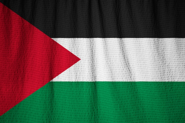 Closeup of ruffled palestinian flag, palestinian flag blowing in wind
