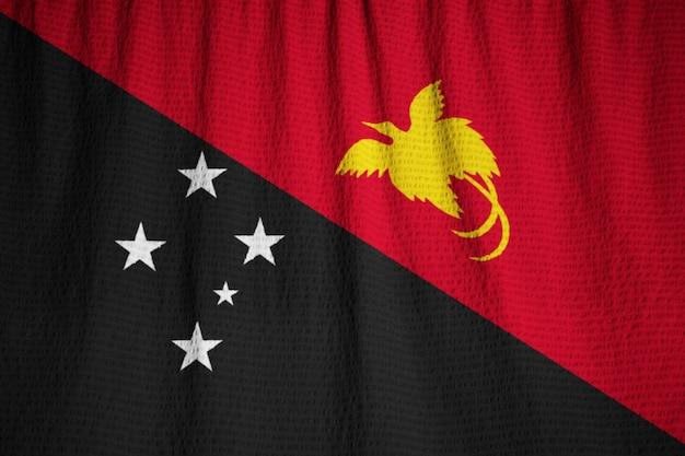 Closeup of ruffled papua new guinea flag, papua new guinea flag blowing in wind