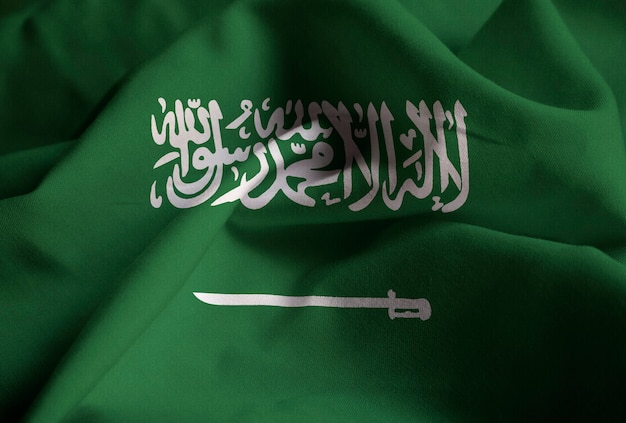 Closeup of ruffled saudi arabia flag, saudi arabia flag blowing in wind