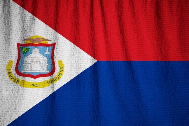 Closeup of ruffled sint maarten flag, sint maarten flag blowing in wind