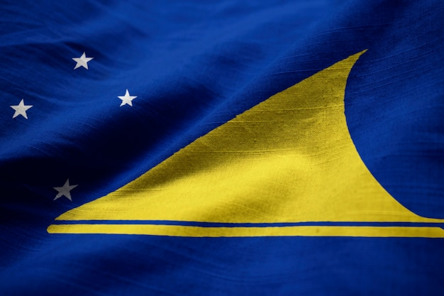 Closeup of ruffled tokelau flag, tokelau flag blowing in wind