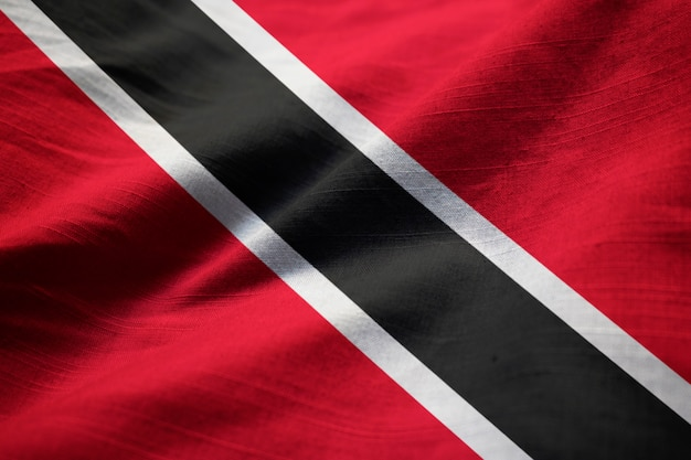 Closeup of ruffled trinidad and tobago flag, trinidad and tobago flag blowing in wind