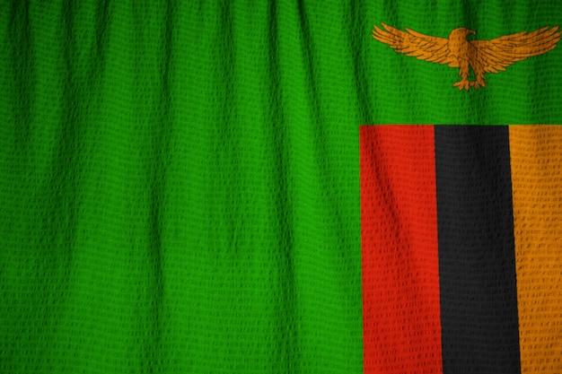 Closeup of ruffled zambia flag, zambia flag blowing in wind