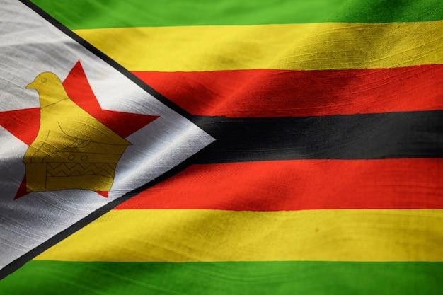 Closeup of ruffled zimbabwe flag, zimbabwe flag blowing in wind