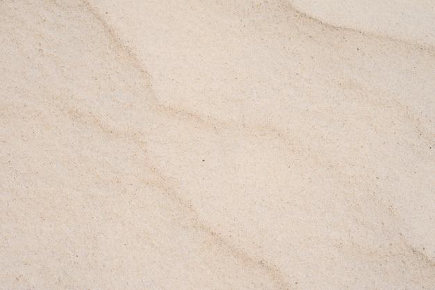 夏の太陽のビーチで砂のテクスチャをクローズアップ