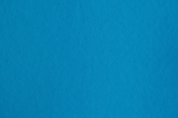 Closeup of seamless blue paper texture for background or artworks