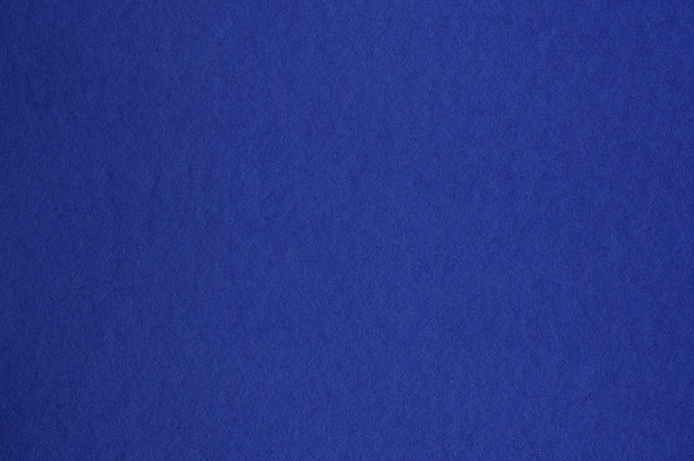 Closeup of seamless dark blue paper texture for background or artworks