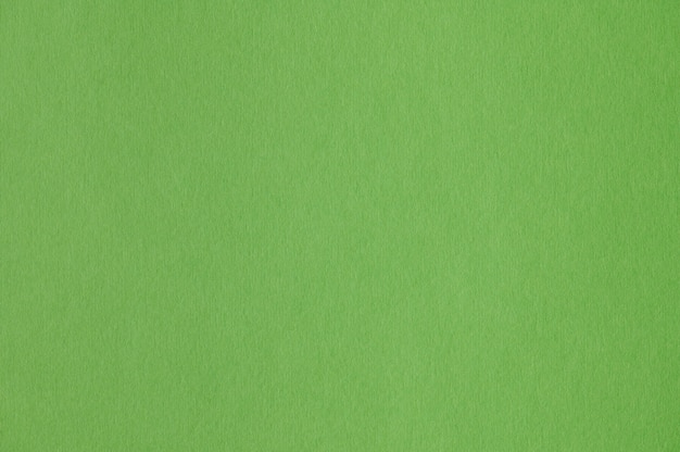 Closeup of seamless green paper texture for background or artworks