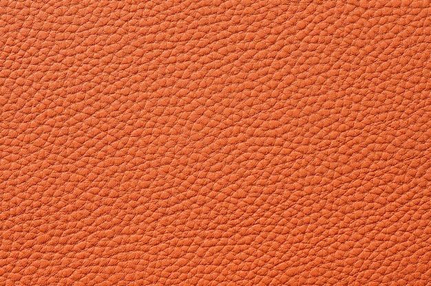 Closeup of seamless orange leather texture for background