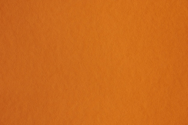 Closeup of seamless orange paper texture for background or artworks