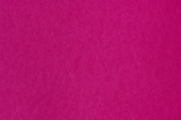 Closeup of seamless pink paper texture for background or artworks
