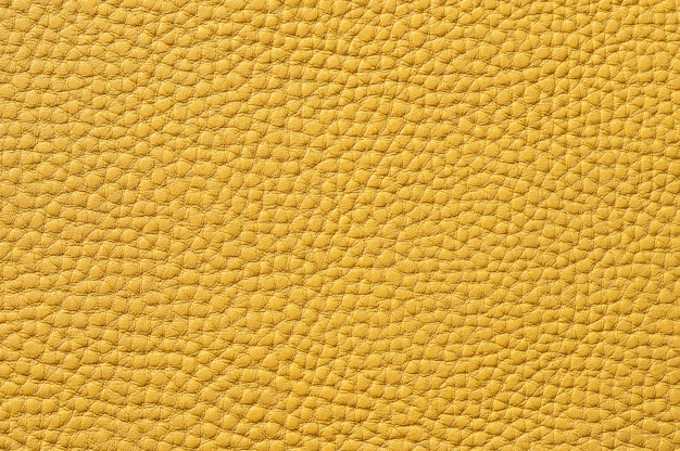 Closeup of seamless yellow leather texture for background