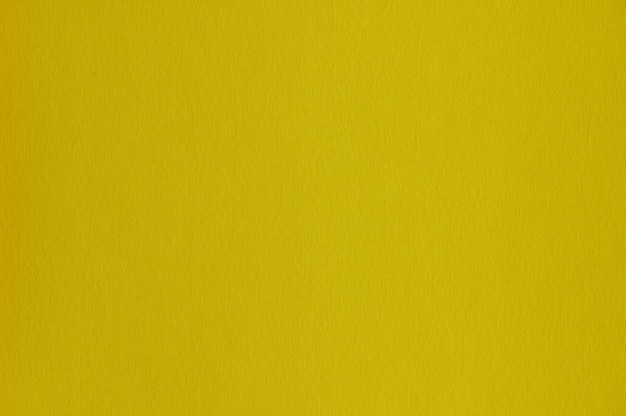Closeup of seamless yellow paper texture for background or artworks
