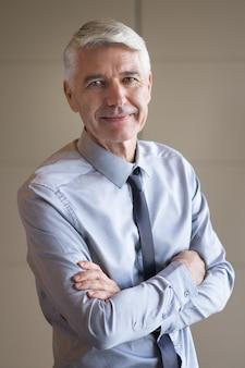Closeup of senior businessman with arms crossed