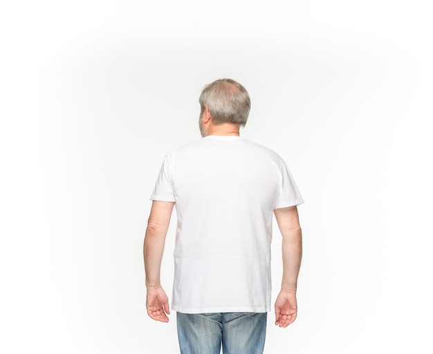 Closeup of senior man's body in empty white t-shirt isolated on white background. clothing, mock up for disign concept with copy space.