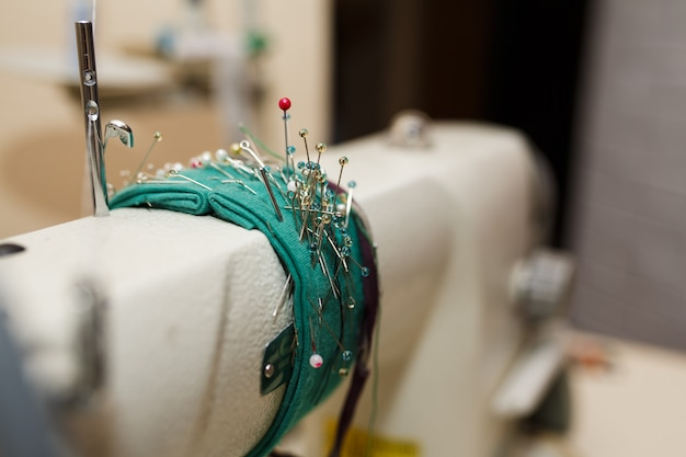 Closeup set of needles for fastening fabric attached to the sewing machine.