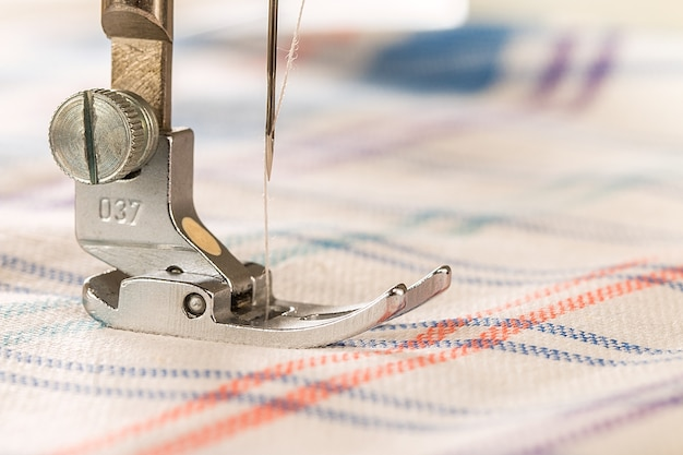 Closeup of sewing machine and fabric empty space for text