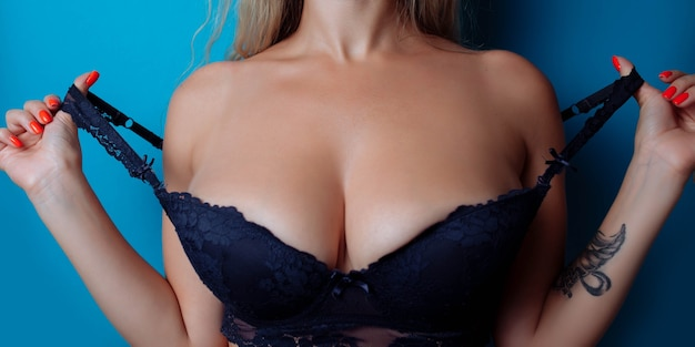 Closeup of sexy breasts in bra womans breasts or big natural boobs in lingerie plastic surgery