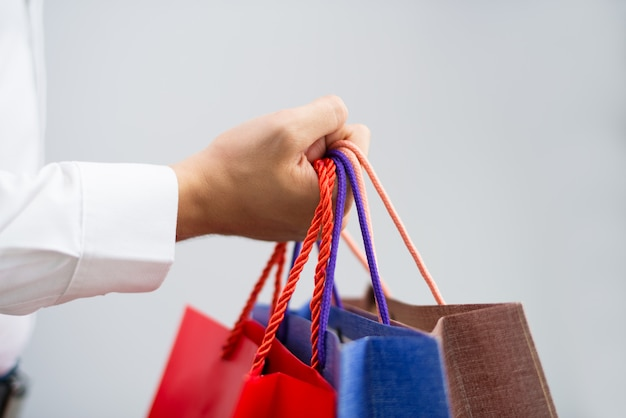 Closeup of shopper holding shopping bags