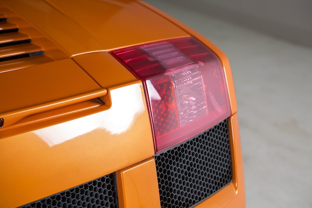 Closeup shot of the backlights of a modern orange car