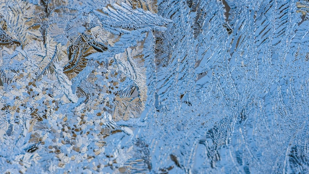 Closeup shot of beautiful frost patterns and textures on a glass