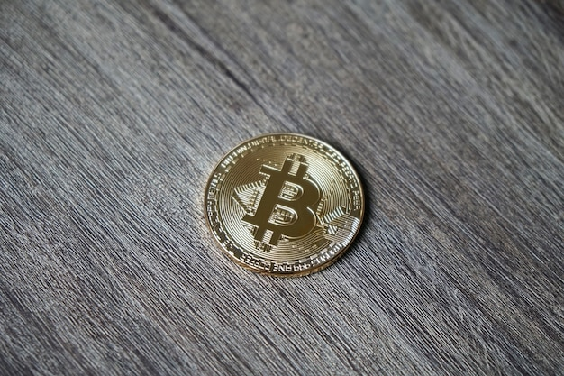 Closeup shot of a bitcoin on a wooden table