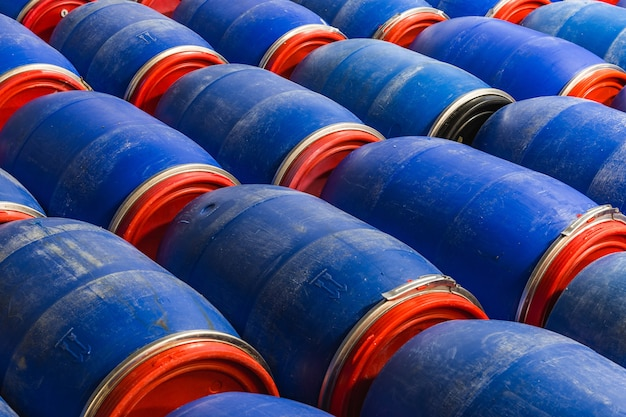 Closeup shot of blue barrels in the factory