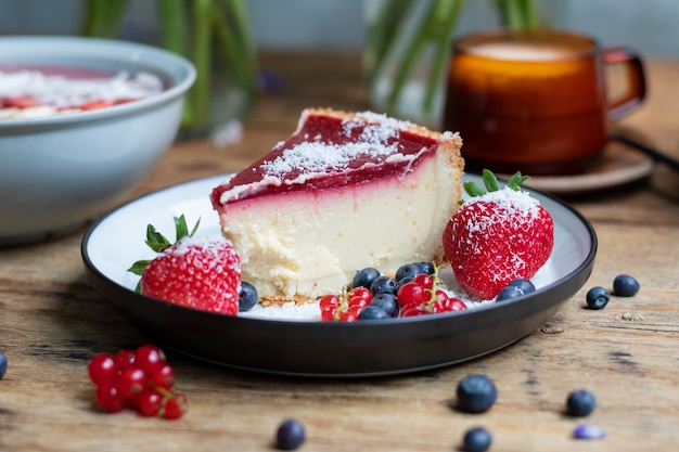 Closeup shot of cheesecake with jelly decorated with strawberries and berries
