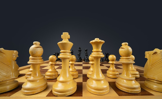 Closeup shot of a chessboard made of brown and black pieces