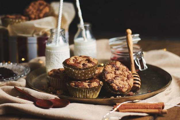 Closeup shot of chocolate muffins with honey and milk