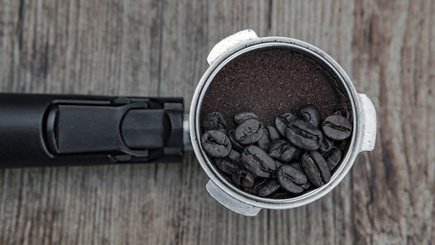 Closeup shot of coffee beans on a coffee powder  - great for background or blog